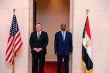 US Secretary of State Mike Pompeo stands with Sudanese General Abdel-Fattah Burhan.