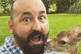 Tasmanian author Bradley Trevor Greive and deer friend.