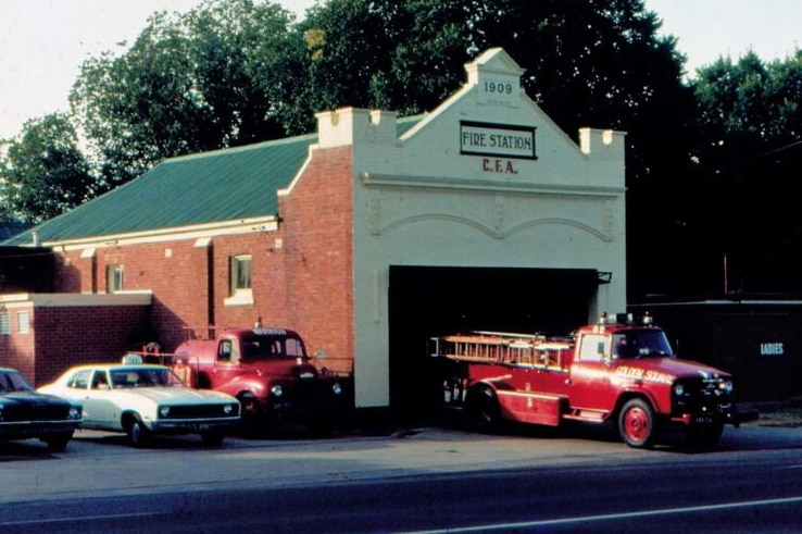 Golden Square Fire Station from 1980, with old fire engine parked outside.