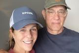 Tom Hanks with his arm around wife Rita.