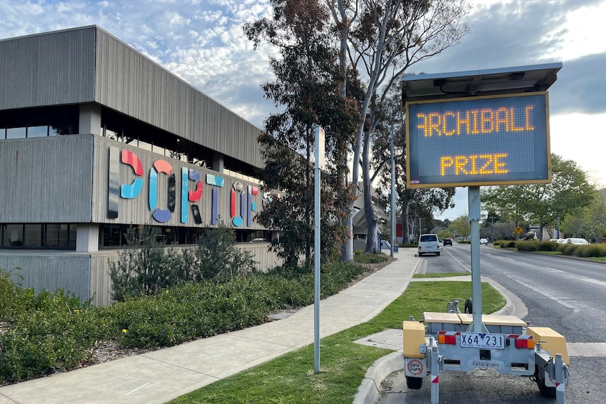 An electronic road sign which reads 'Archibald Prize' is parked on the main road outside the Gallery builidng