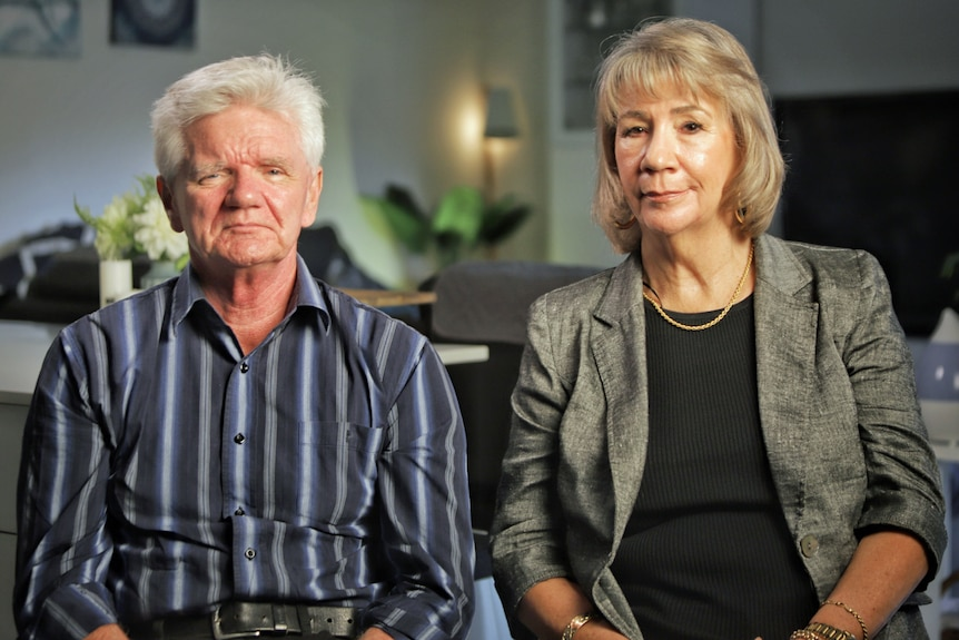 A man and woman sit next to each other.