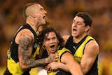 Dustin Martin, Daniel Rioli and Jason Castagna celebrate as a trio