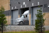 A truck is shown coming out of a roller gate at the Pfizer Global Supply Kalamazoo manufacturing plant.