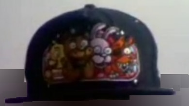 A black cap showing colourful cartoon animals embroidered into the front.