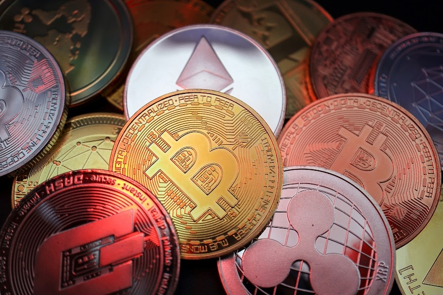 Representations of cryptocurrencies including Bitcoin, Dash, Ethereum, Ripple and Litecoin.