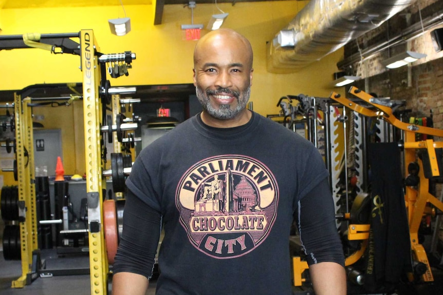 A man standing in a gym