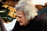 Woman seeks shelter after Italy quake