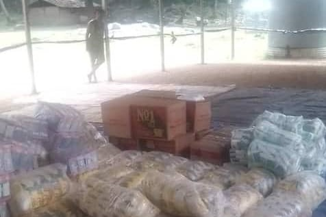 Packages wrapped in plastic lay on the floor of a warehouse.