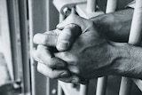 File photo: Hands on prison bars (Getty Creative Images: Dick Luria)