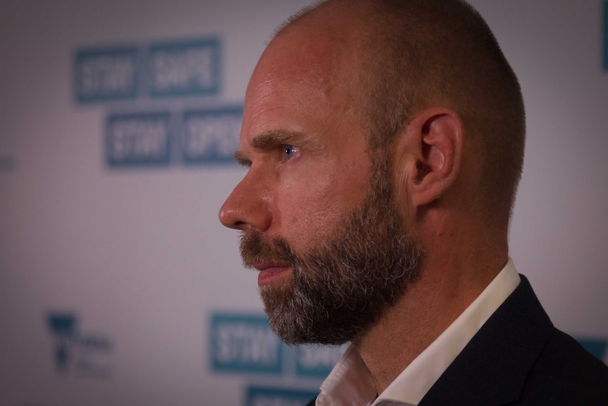 A close up of Jeroen Weimar speaking at a press conference.