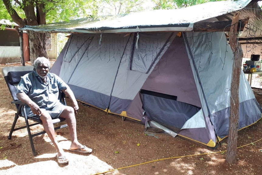 Djambawa Marawili AM outside his tent-house house at Baniyala in December 2020