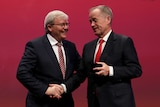 Kevin Rudd and Bill Shorten smile in front of a red background