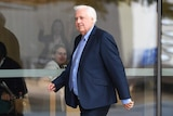 Clive Palmer arrives at the Supreme Court in Brisbane on August 3, 2017.