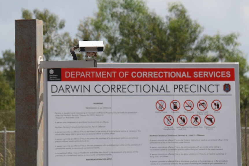 Sign and security lighting at the entrance of the Darwin Correction Precinct, in Holtze.