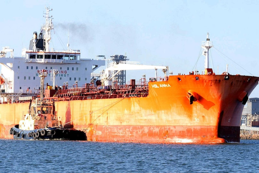 A large ship leaving a port.