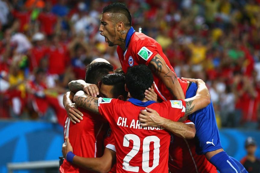 Chile celebrates its second goal against Australia