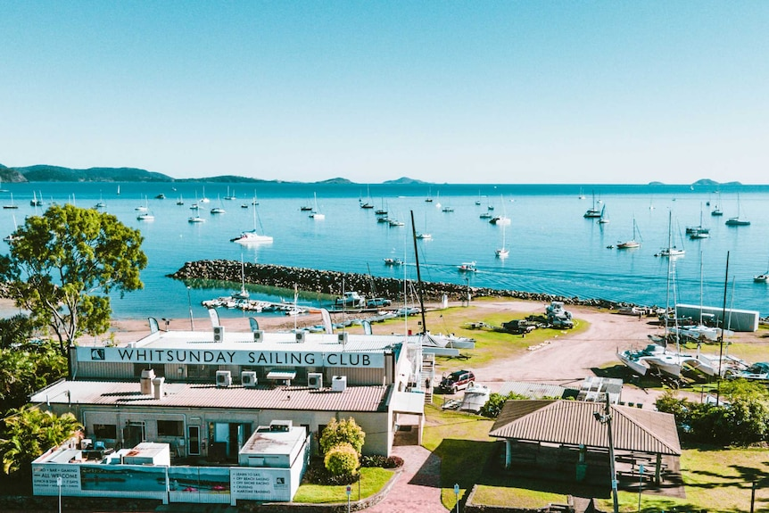 An aerial photo of the Whitsunday Sailing Club, showing the ocean and islands in the background.