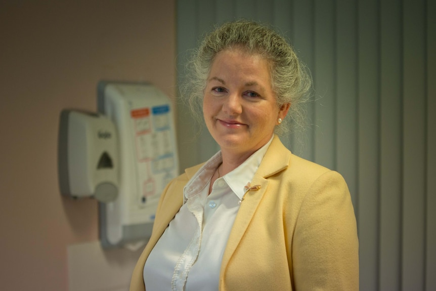 A portrait shows breast surgeon Dr Lisa Rippy