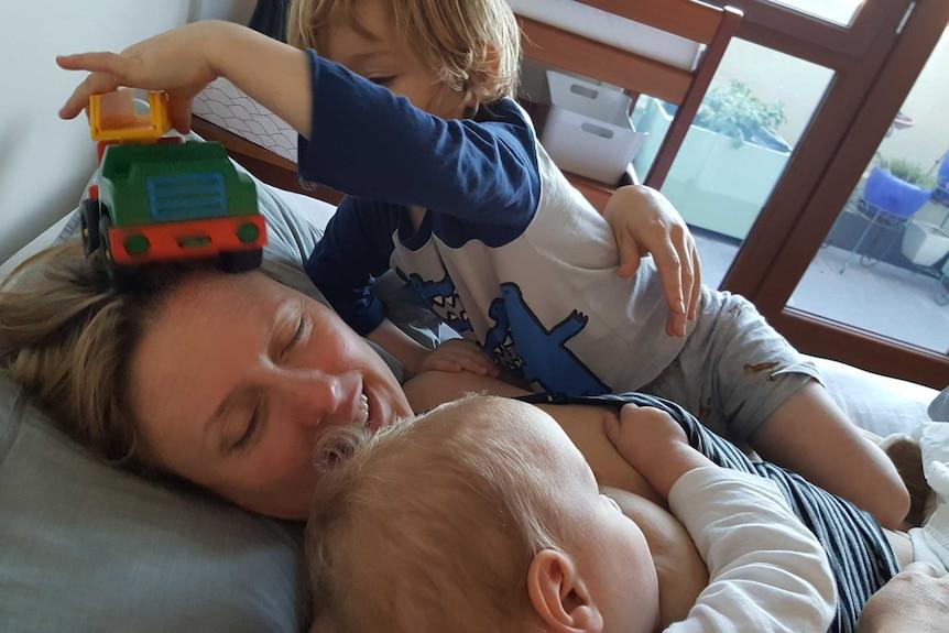 Marion with eldest son William and breastfeeding Alexander