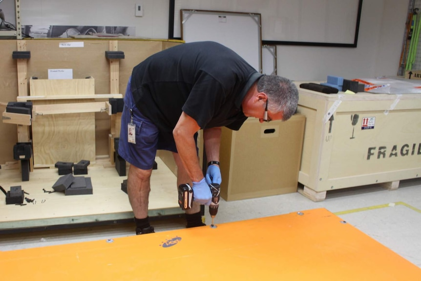 Pete Faulkner sealing the lid of the crate carrying the Blaue map from Canberra to Sydney.