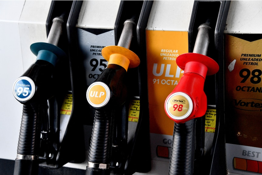 Nozzles labeled with different types of fuel are seen at a filling station in Sydney.