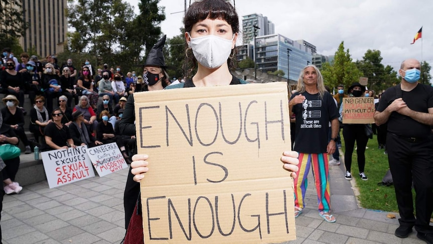 Protester in Victoria Square calling for an end to sexual violence and harassment.