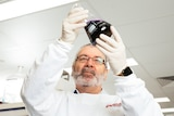 Griffith University Professor Nigel McMillan works in a lab.
