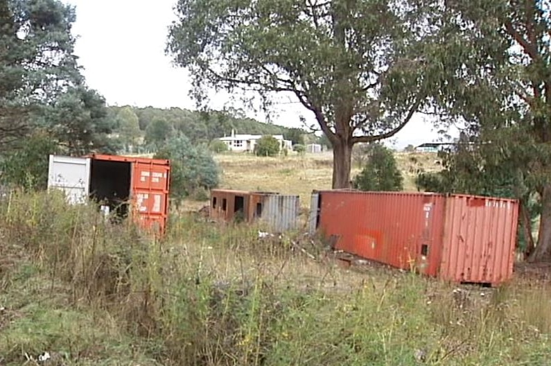 Shipping containers at the Mount Lloyd property where a woman died.