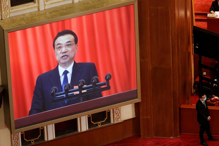 Chinese Premier Li Keqiang is seen on a screen as he delivers a speech at the opening session of the National People's Congress.