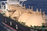 LNG tanker offshore WA, close up with LNG printed on side of ship