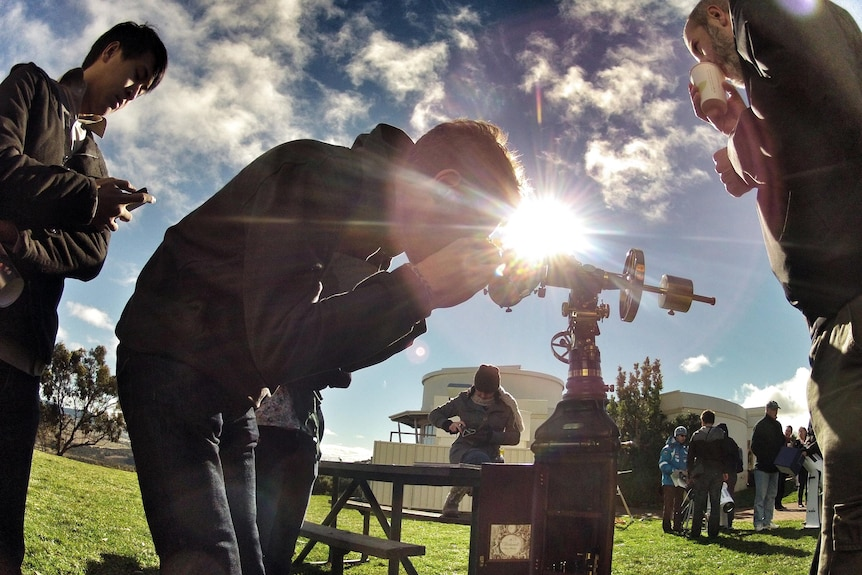 Amateur astronomers watch the transit of Venus at Mt Stromlo Observatory in Canberra.