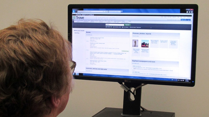A woman looks up the Trove website developed by the National Library of Australia.