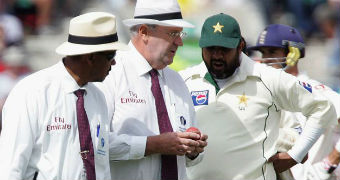 Umpires Bill Doctrove and Darrell Hair show the ball to Pakistan's captain Inzamam-ul-Haq
