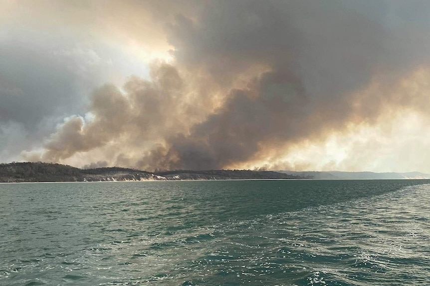 Bushland on fire on Fraser Island, as seen from the ocean
