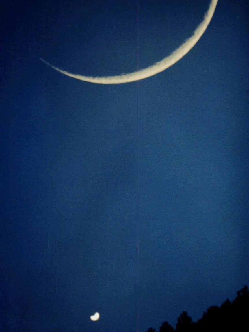 Crescent Moon and brilliant crescent Venus
