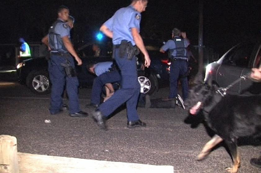 Police officers arrest party goer