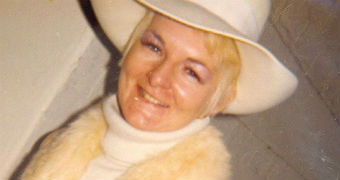 An archive photo of Shirley Finn, wearing a cream hat, cream jumper and fur scarf.