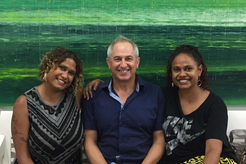 Michael Eather (centre) flanked by his daughters Alice and Noni