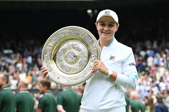 Ash Barty with the Wimbledon trophy.