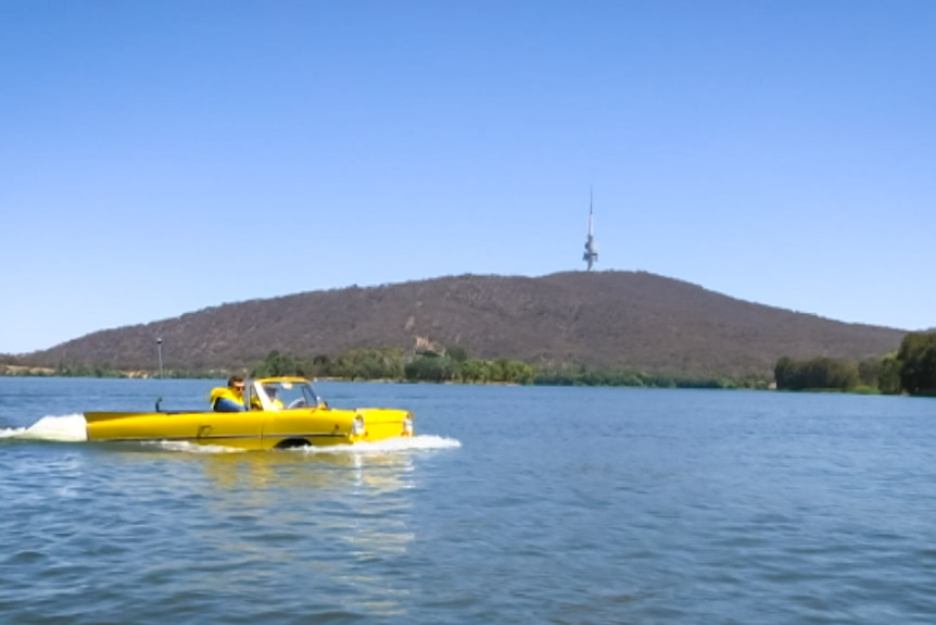 Ian Oliver driving his car through Lake Burley Griffin.
