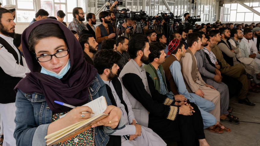 AnAfghanfemale journalist attends a Taliban officials news conference.