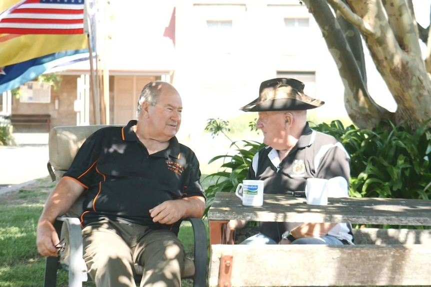 Vietnam War veterans Greg Carter and Ron Billing having a cup of tea together.