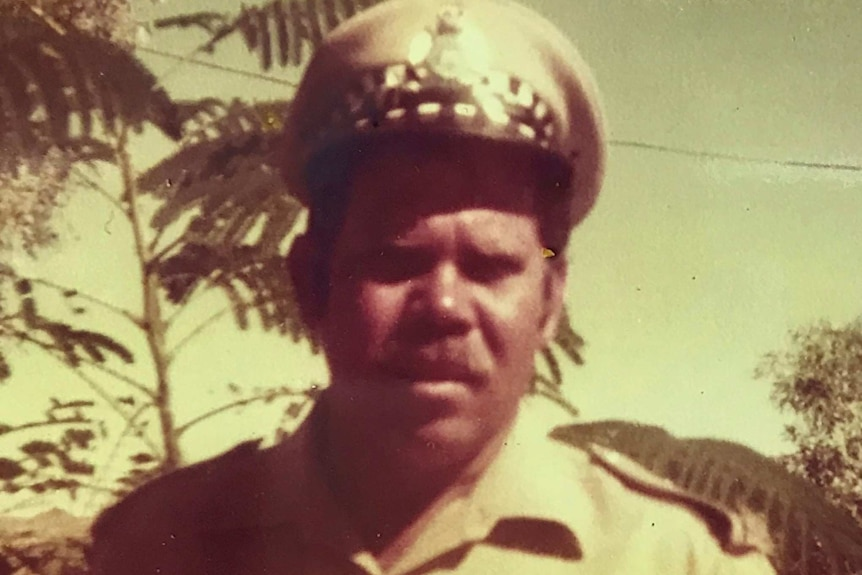 An archive photo of an Indigenous police officer in his uniform
