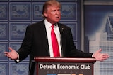 Donald Trump standing at a podium delivering an economic speech.