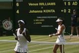 Venus Williams celebrates after beating Britain's Johanna Konta at Wimbledon on July 13, 2017.