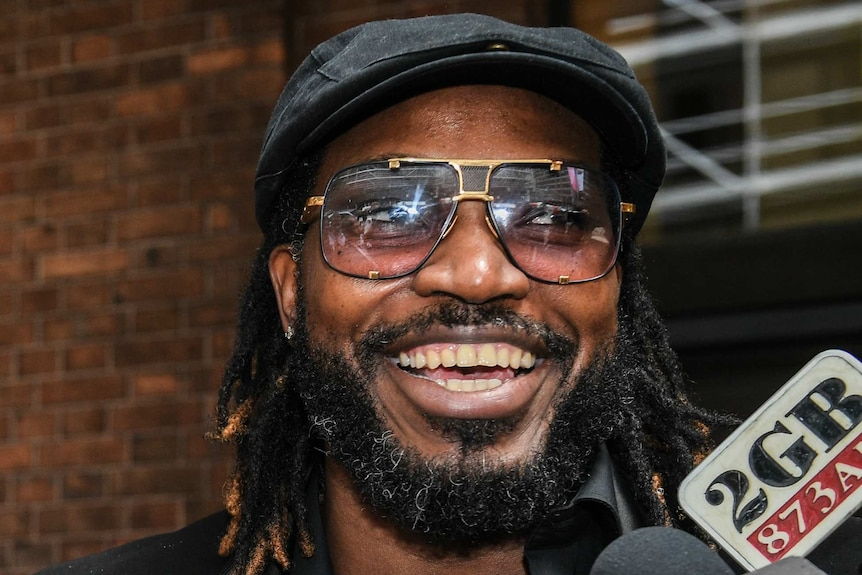 Chris Gayle outside court