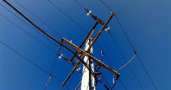 Overhead wires on an electricity pole.