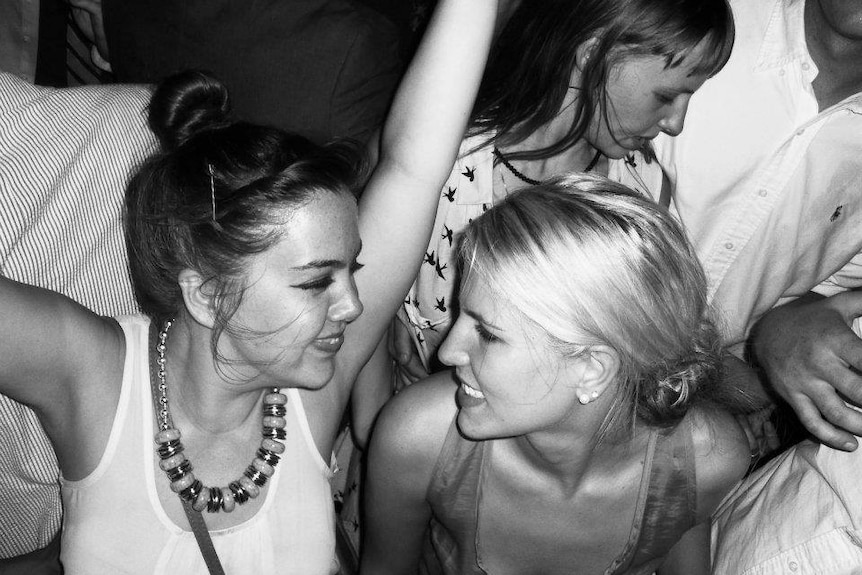 Black and white photo of Summer Land with her friend Emily dancing at an event.