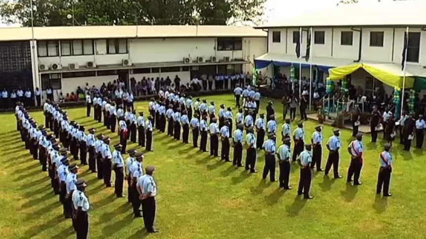 Solomon Islands police officers attend a special ceremony at the police headquarter in Honiara, on the day of the rearmament.
